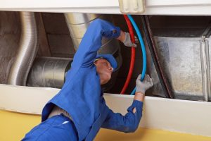 commercial plumber checking lines