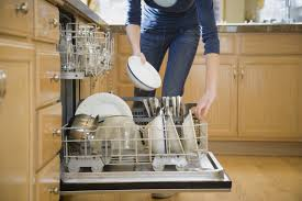 woman filling dishwasher