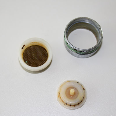 Clean a faucet aerator to remove hard-water buildup.