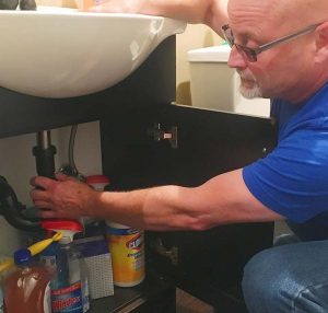 expert plumber working on plumbing pipe maintenace