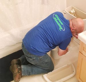 simpson plumber fixing a leaking toilet
