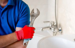 Plumber holding wrench